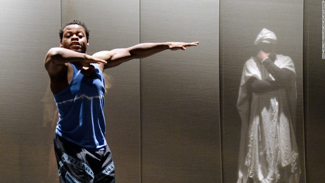 "Nigerian dancer and choreographer Qudus Onikeku (left) and Cameroonian actor Emil Abossolo perform a scene of Onikeku's creation ""Qaddish"" at the Salle Benoit XII in Avignon, as part of the 67th international theater festival."