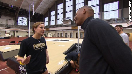 Purdue University assistant track and field coach Chris Huffins discusses strategy with Brown.