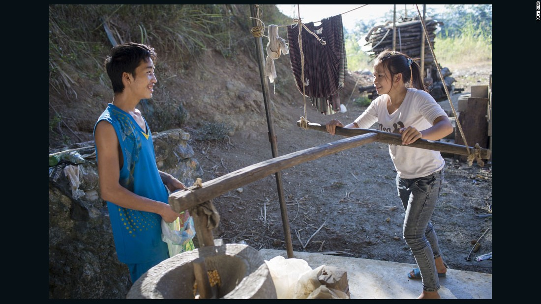 Cai and her husband Ming use a neighbor's hand mill to grind corn. Ming says he misses his single life because he could hang out a lot with his friends before, but now his friends won't take him out because they are afraid that Cai will disapprove.