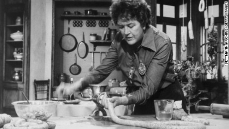 Julia Child demonstrates the stuffing of sausages.