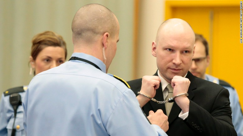Norwegian mass killer Anders Behring Breivik has his handcuffs removed in court prior to giving testimony.