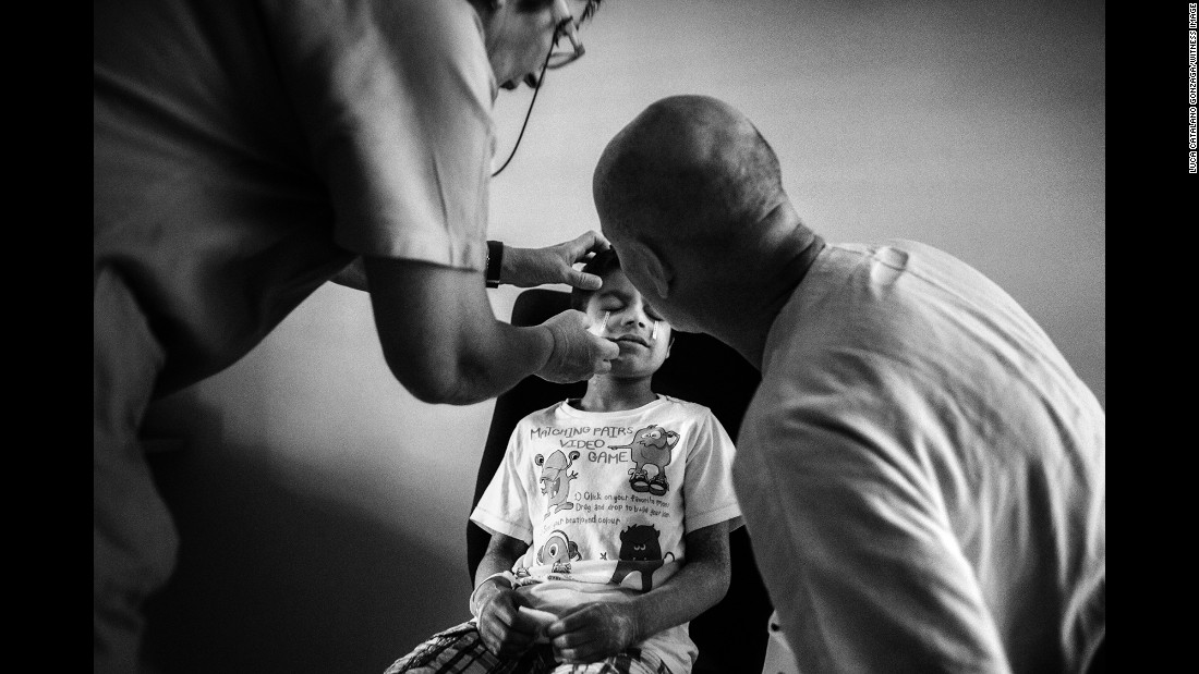 Alex undergoes an eye exam at a hospital in Trieste, Italy. Alex has an ulcerated cornea and suffers from photophobia, meaning that he is incredibly sensitive to light and it can have a painful, blinding effect on him. He's already losing his eyesight.