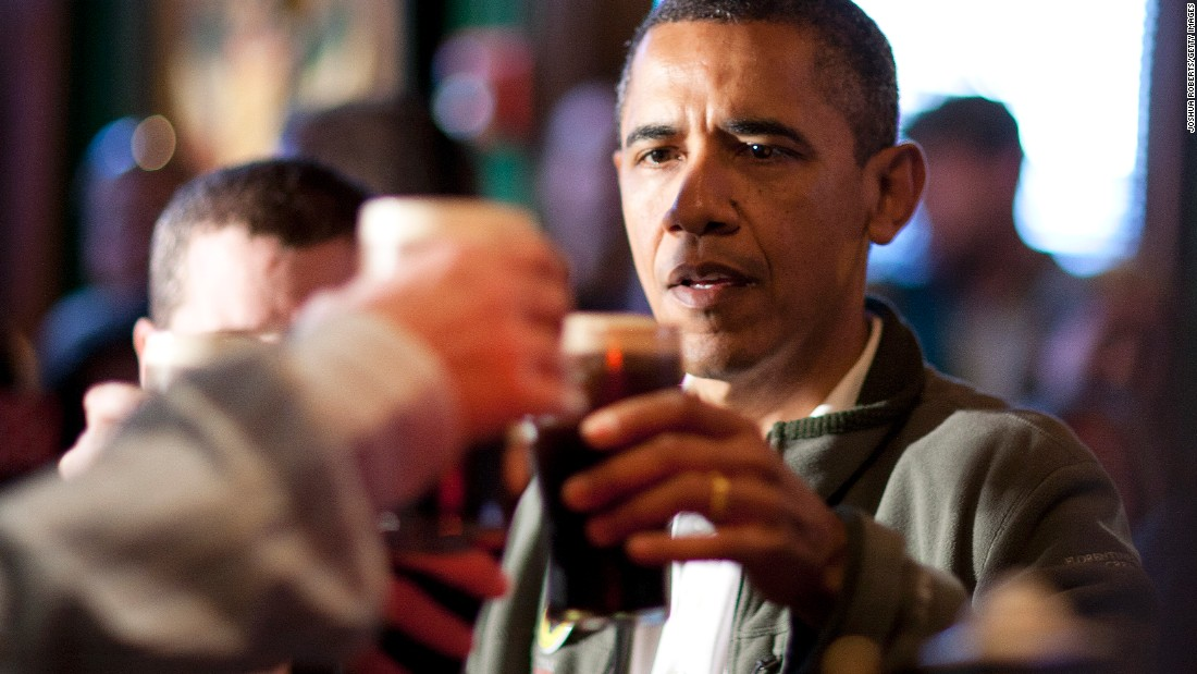 President Barack Obama toasts with a Guinness beer as he visits a Washington pub on St. Patrick's Day in 2012.