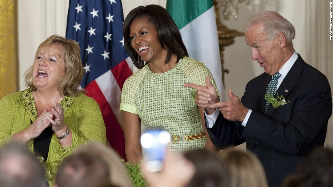Vice President Joe Biden, first lady Michelle Obama and Fionnuala Kenny, wife of Irish Prime Minister Enda Kenny, laugh at a joke by President Obama during a St. Patrick's Day reception at the White House on March 20, 2012.