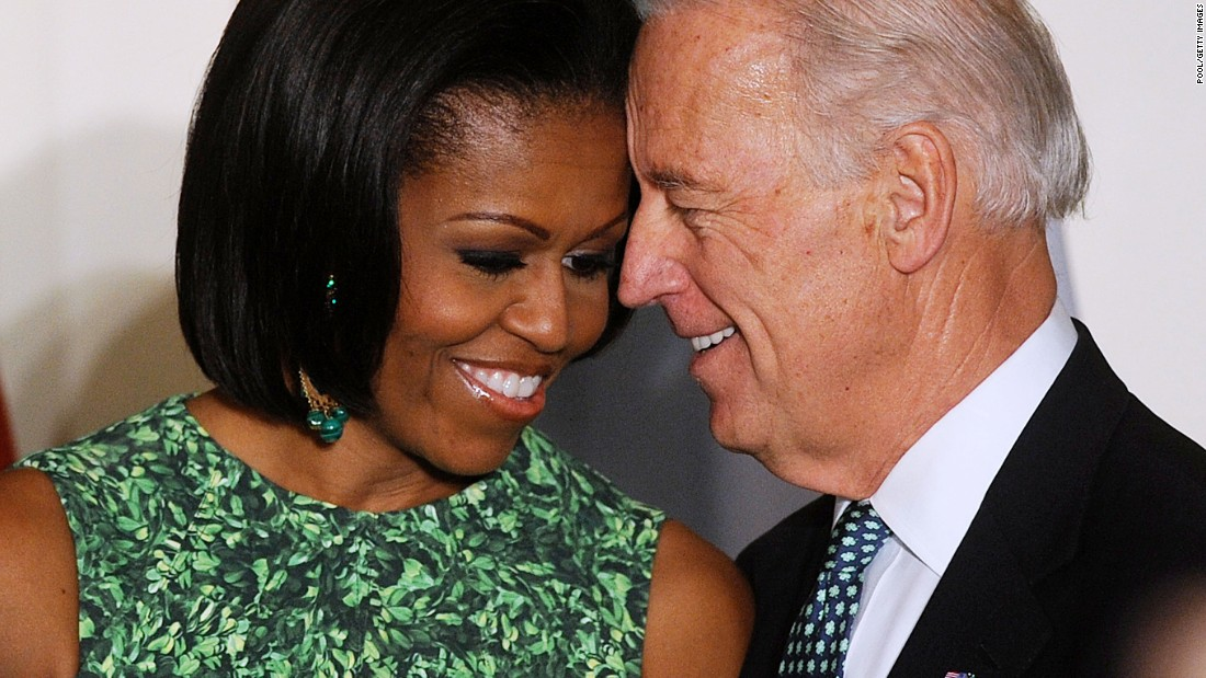 Michelle Obama and Biden attend a St. Patrick's Day reception in the East Room of the White House on March 17, 2011 in Washington, D.C.