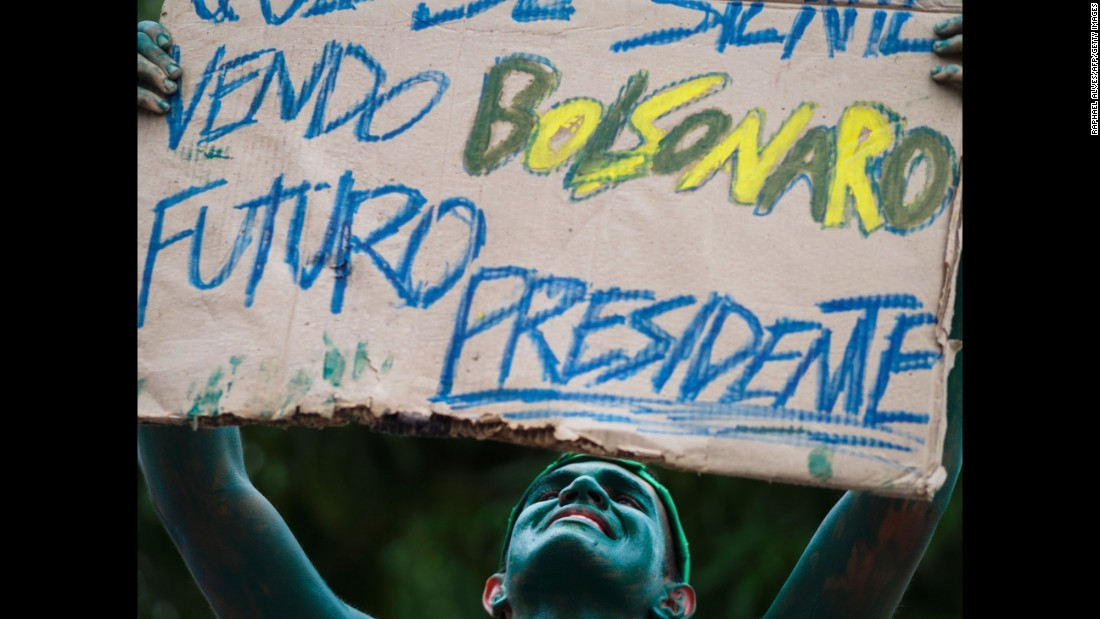A painted man in Manaus, Brazil, holds a placard supporting Congressman Jair Bolsonaro for President on March 13.