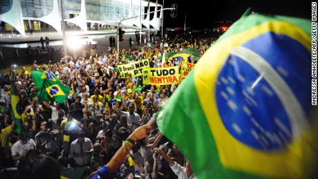 Demonstrators protest against corruption in front of Planalto Palace in Brazil on March 16.