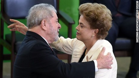 Former Brazilian president Luiz Inacio Lula da Silva (L) hugs Brazilian president Dilma Rousseff during Lula's swear in ceremony as chief of staff, in Brasilia on March 17, 2016. Rousseff appointed Luiz Inacio Lula da Silva as her chief of staff hoping that his political prowess can save her administration. The president is battling an impeachment attempt, a deep recession, and the fallout of an explosive corruption scandal at state oil giant Petrobras.       AFP PHOTO/EVARISTO SA / AFP / EVARISTO SA        (Photo credit should read EVARISTO SA/AFP/Getty Images)
