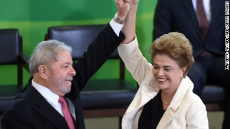 Former Brazilian president Luiz Inacio Lula da Silva (L) and Brazilian president Dilma Rousseff gesture during Lula's swear in ceremony as chief of staff, in Brasilia on March 17, 2016. Rousseff appointed Luiz Inacio Lula da Silva as her chief of staff hoping that his political prowess can save her administration. The president is battling an impeachment attempt, a deep recession, and the fallout of an explosive corruption scandal at state oil giant Petrobras.       AFP PHOTO/EVARISTO SA / AFP / EVARISTO SA        (Photo credit should read EVARISTO SA/AFP/Getty Images)
