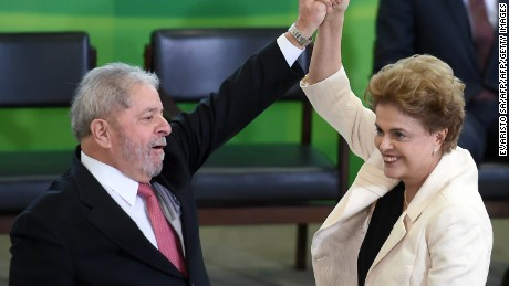 Former Brazilian president Luiz Inacio Lula da Silva (L) and Brazilian president Dilma Rousseff gesture during Lula's swear in ceremony as chief of staff, in Brasilia on March 17, 2016. Rousseff appointed Lula da Silva as her chief of staff hoping that his political prowess can save her administration. The president is battling an impeachment attempt, a deep recession, and the fallout of an explosive corruption scandal at state oil giant Petrobras. AFP PHOTO/EVARISTO SA EVARISTO SA / AFP / AFP / EVARISTO SA        (Photo credit should read EVARISTO SA/AFP/Getty Images)