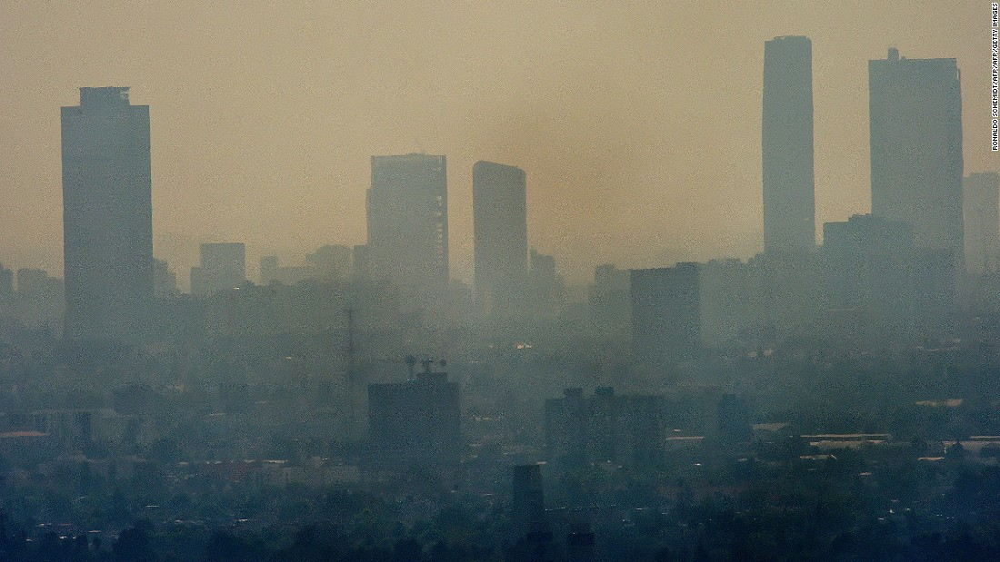 Smog envelopes skyscrapers in Mexico City in December 2015. It was considered the most polluted city in the world during the 1990s and its problems today, as this picture shows, are far from over.