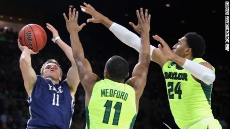 Makai Mason, left, of the Yale Bulldogs shoots as he is defended by Lester Medford, center,  and Ishmail Wainright of the Baylor Bears. Mason led Yale with 31 points.