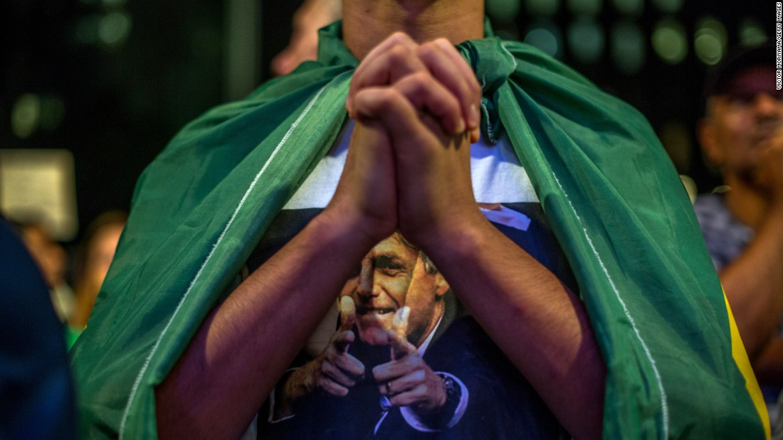 A demonstrator clasps his hands during protests in Sao Paulo on March 17.