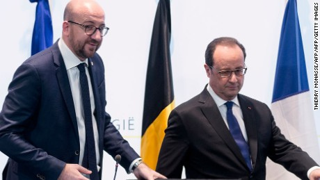 "Belgium's Prime Minister Charles Michel (L) and French President Francois Hollande arrive to give a joint press conference on 18 March 2016 in Brussels regarding a police action in Molenbeek-Saint-Jean in Brussels.  Police arrested three people including key Paris attacks suspect Salah Abdeslam in a raid in Brussels on Friday, Belgian Prime Minister Charles Michel said. Hollande said Abdeslam had been arrested ""with two accomplices and had been formally identified,"" adding that he expected his extradition ""as quickly as possible"".  AFP PHOTO / THIERRY MONASSE / AFP / THIERRY MONASSE        (Photo credit should read THIERRY MONASSE/AFP/Getty Images)"