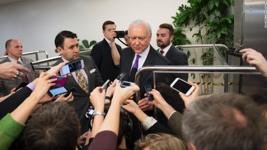 U.S. Sen. Orrin Hatch wades through reporters in Washington who were asking about the President's Supreme Court nominee on Wednesday, March 16.