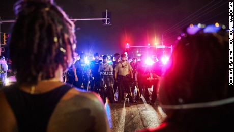 St. Louis County Police and the Missouri State Highway Patrol watch Ferguson marchers.