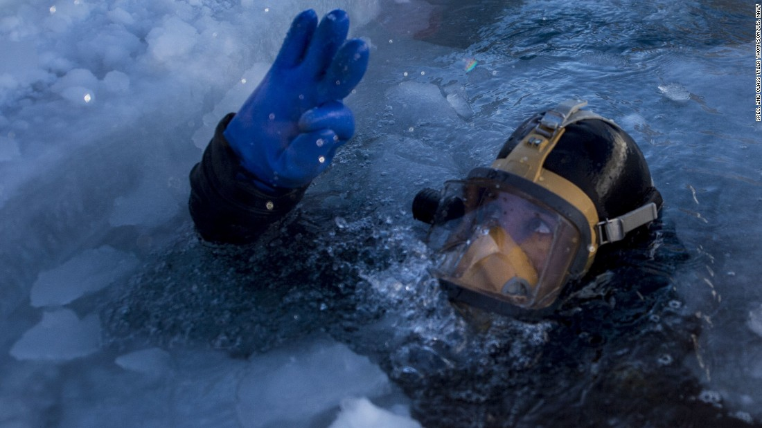 Coast Guard Diver 2nd Class Garett Brada performs an ice dive in the Arctic Circle during ICEX 2016.