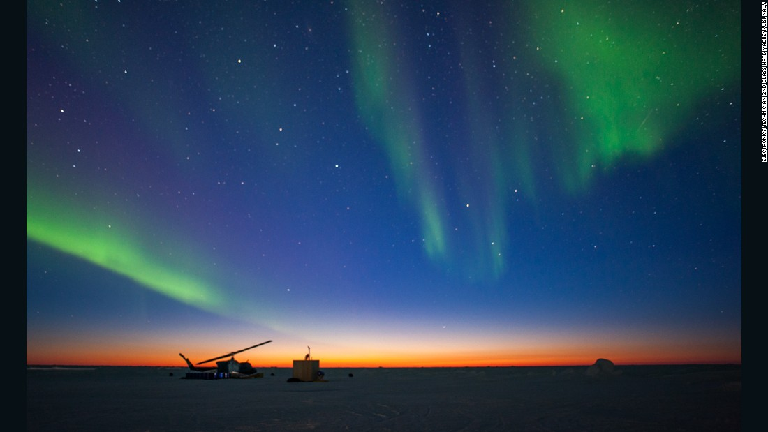The aurora borealis appears over Ice Camp Sargo as the sun sets during ICEX 2016.