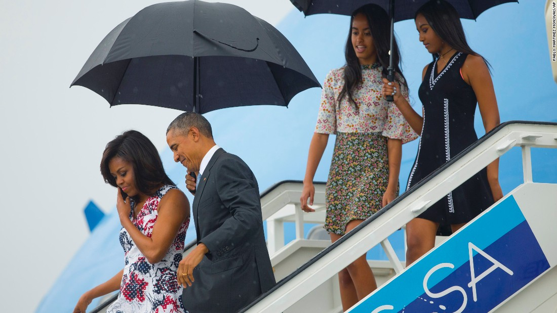 Obama and his family exit Air Force One on March 20.