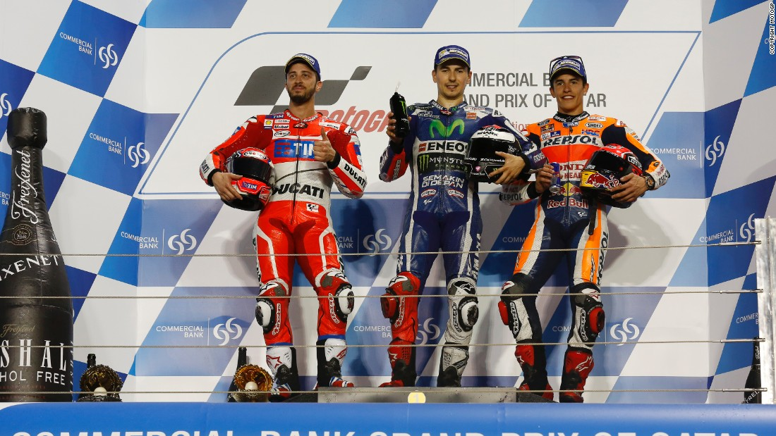 Yamaha's Jorge Lorenzo stands proudly atop the Qatar podium after his victory in this season's inaugural Grand Prix. Andrea Dovizioso of Ducati claimed second, while Marc Marquez of Honda seized third.