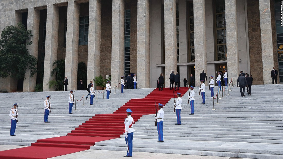 Obama walks up the stairs of the Palace of the Revolution on March 21.