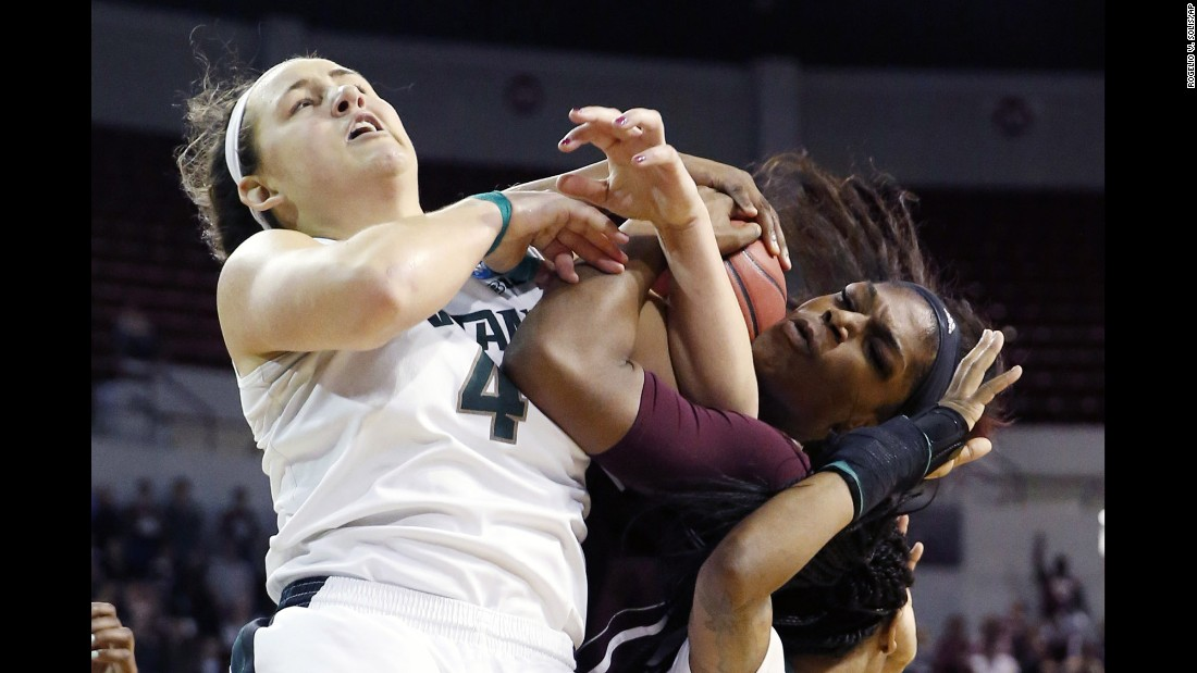 Michigan State's Jasmine Hines, left, battles Mississippi State's Chinwe Okorie for a ball during an NCAA Tournament game in Starkville, Mississippi, on Sunday, March 20. The home team advanced with a 74-72 victory.