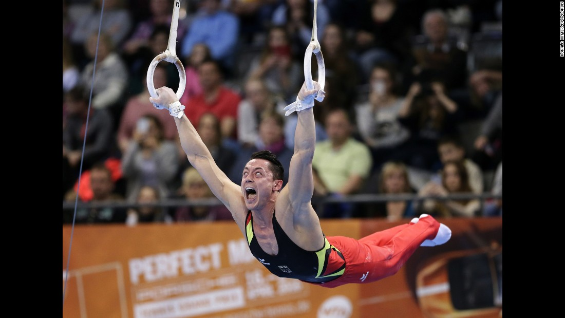 German gymnast Andreas Toba practices on the rings Saturday, March 19, at the World Cup event in Stuttgart, Germany.