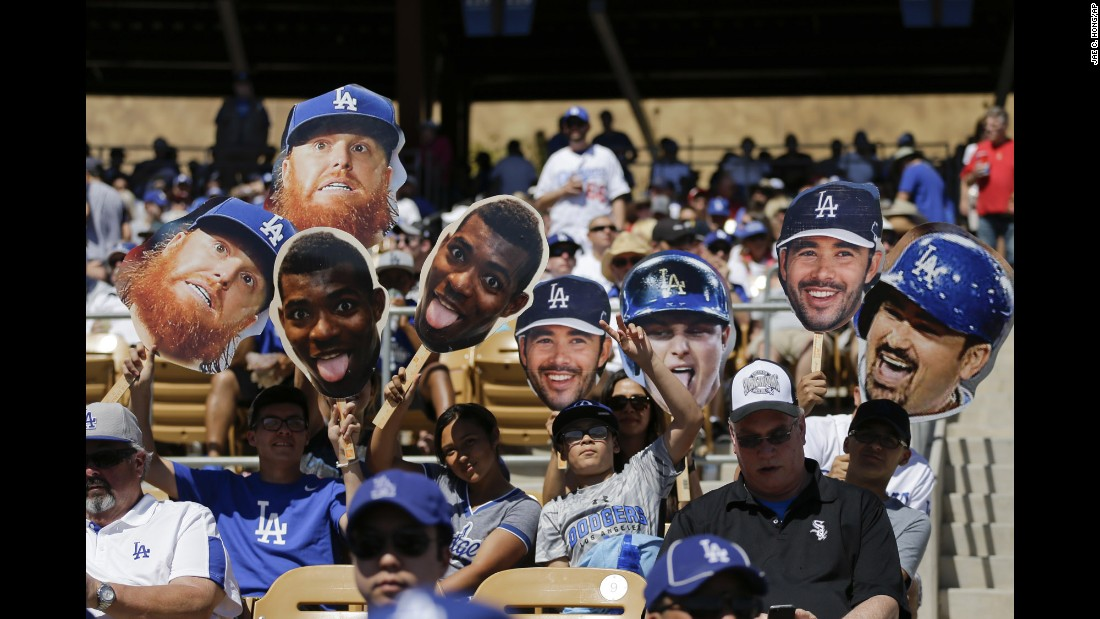 Fans of the Los Angeles Dodgers cheer for their team while watching a spring-training game in Phoenix on Saturday, March 19.
