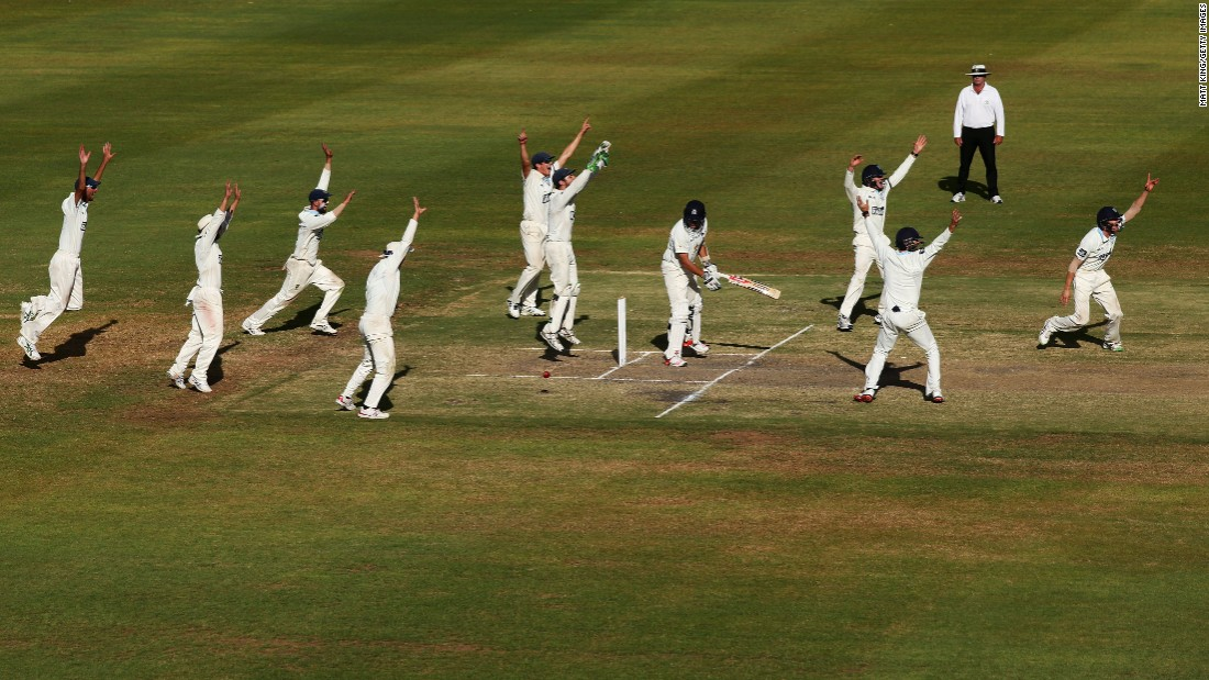 Cricket players from New South Wales celebrate Friday, March 18, during a Sheffield Shield match against Victoria in Alice Springs, Australia. The match ended in a draw.