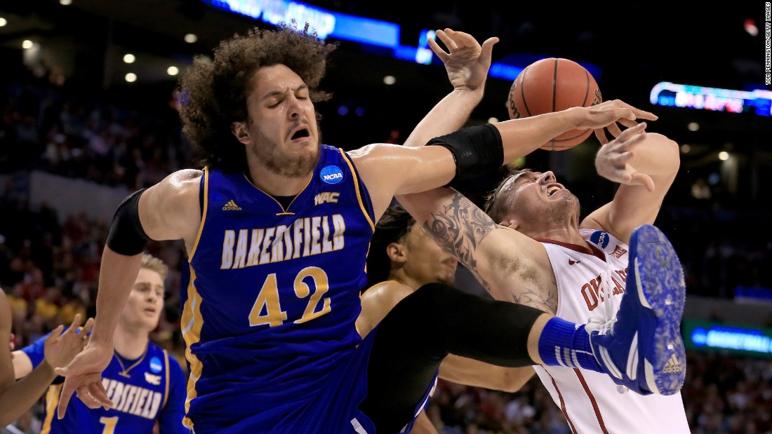 Oklahoma's Ryan Spangler, right, has the ball knocked away by members of Cal State Bakersfield during an NCAA Tournament game on Friday, March 18. Oklahoma won 82-68 to advance to the second round.