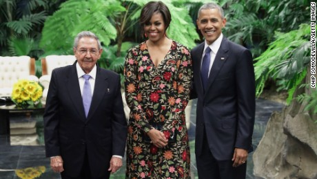 Cuban President Raul Castro poses with first lady Michelle Obama and President Barack Obama before a state dinner at the Palace of the Revolution in Havana, Cuba, on Monday, March 21.
