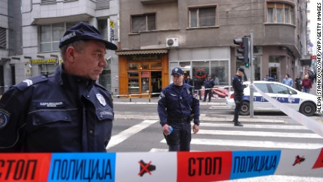 Policemen stand guard near a bakery where a man blew himself up in the center of the Serbian capital Belgrade on March 21, 2016.