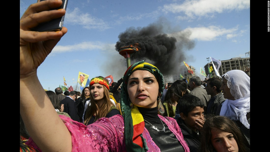 A woman in Diyarbakir, Turkey, takes a selfie during celebrations of the Nowruz holiday on Monday, March 21.