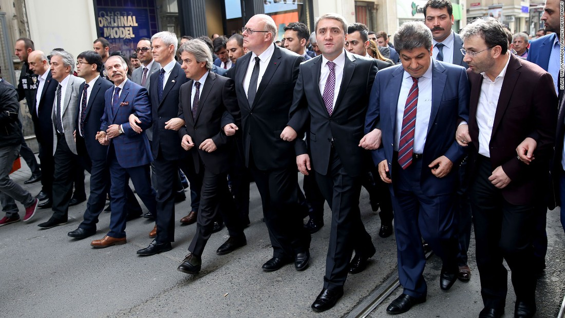 Mayors of Istanbul districts walk with consuls from various countries, including Belgium, during a protest condemning terrorism on March 22.