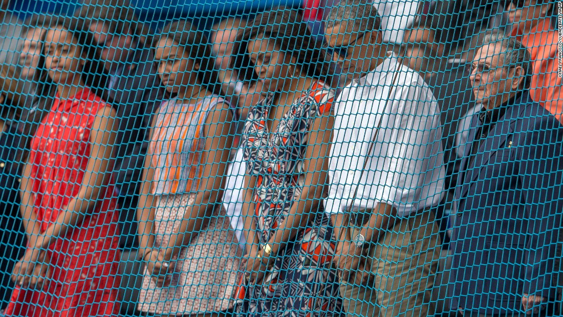 U.S. President Barack Obama and his family observe a moment of silence as they attend a baseball game in Havana, Cuba, with Cuban President Raul Castro, right, on March 22.