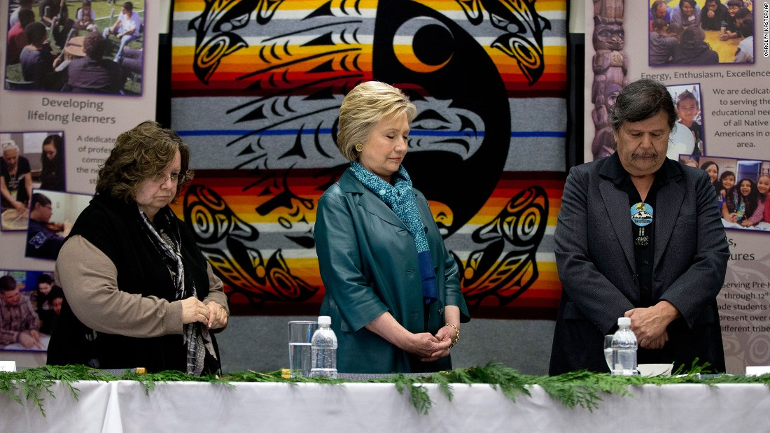 Democratic presidential candidate Hillary Clinton, center, stands for a moment of silence during a roundtable with tribal leaders in Puyallup, Washington, on March 22.