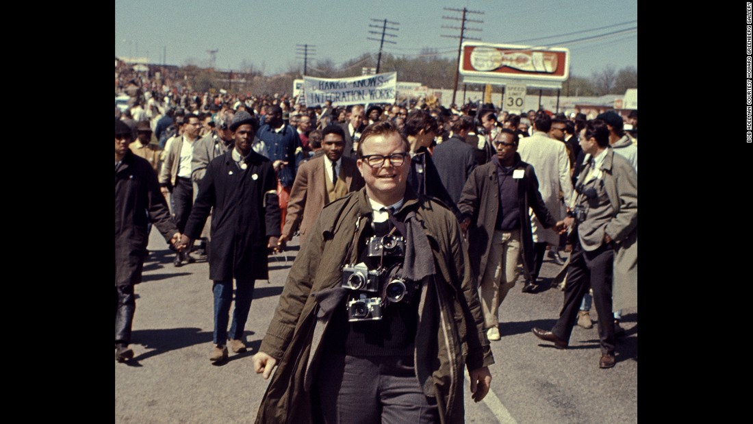 "Adelman attends the <a href=""http://www.cnn.com/2015/01/06/us/gallery/selma-bloody-sunday-1965/index.html"" target=""_blank"">Selma-to-Montgomery civil rights march</a> in 1965. ""When I photographed, I was intent on telling the truth as best I saw it and then to help in doing something about it,"" Adelman<a href=""http://www.loc.gov/today/pr/2014/14-154.html"" target=""_blank""> told the Library of Congress.</a>"