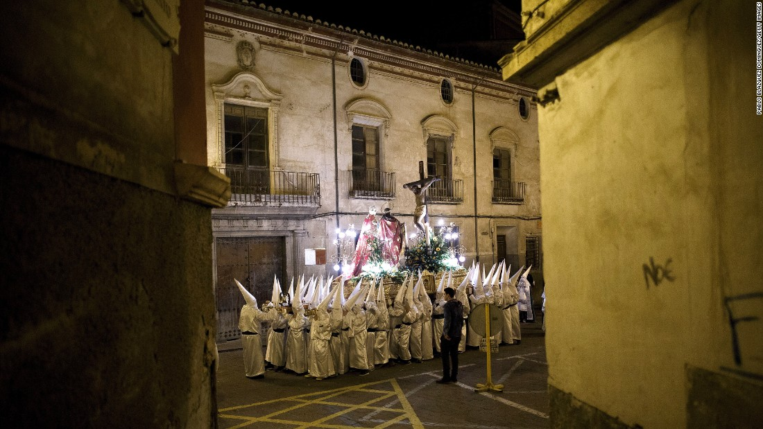 Penitents carry an image of Jesus Christ through the streets in Caravaca de la Cruz, Spain, on Thursday, March 24.