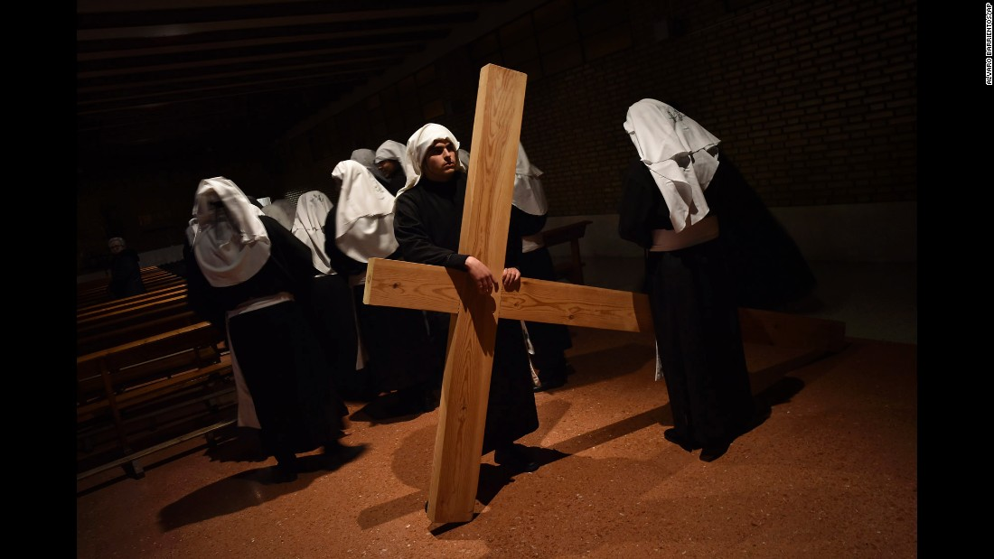 Penitents take part in a procession in Calahorra, Spain, on March 24.