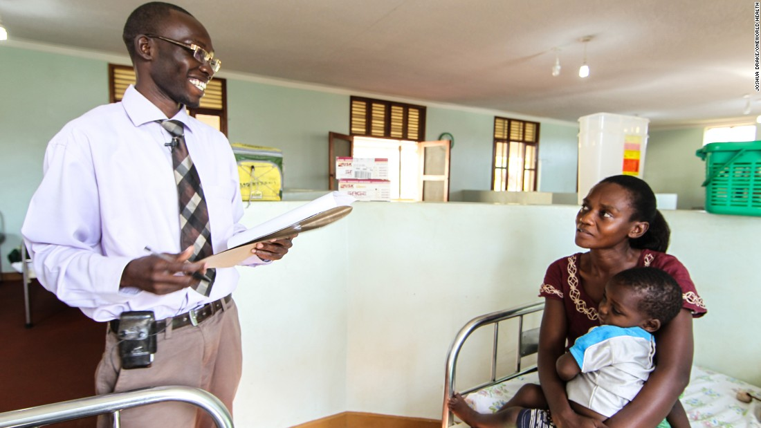 Dr. Dan, a medical officer at OneWorld Health's Masindi Kitara Medical Center, meets with a mother and her child.
