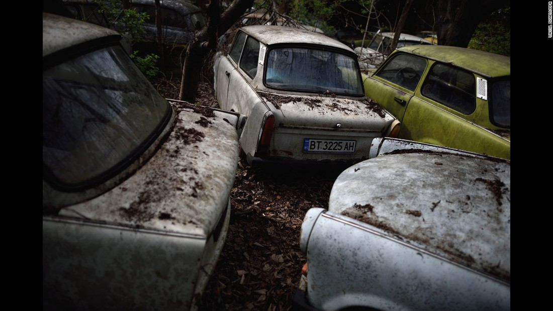 Trabant cars belonging to Ivailo Antov are piled together in Hotnica, Bulgaria, on Tuesday, March 22. Antov is trying to amass the world's largest collection of Trabants, which were produced in East Germany. He has 70 stored in his yard.