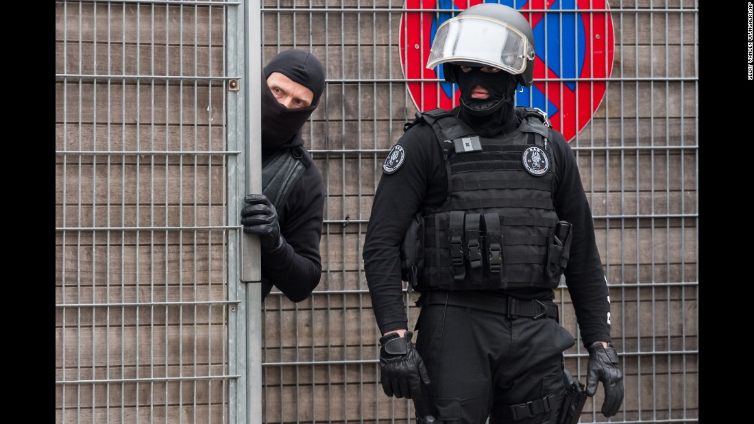 "Police officers guard an entrance of a school during a raid in the Molenbeek neighborhood of Brussels, Belgium, on Friday, March 18. Belgian officials said <a href=""http://www.cnn.com/2016/03/18/world/paris-attack-salah-abdeslam-fingerprints-capture/"" target=""_blank"">they captured Salah Abdeslam,</a> Europe's most-wanted fugitive who is a suspect in the Paris terror attacks."