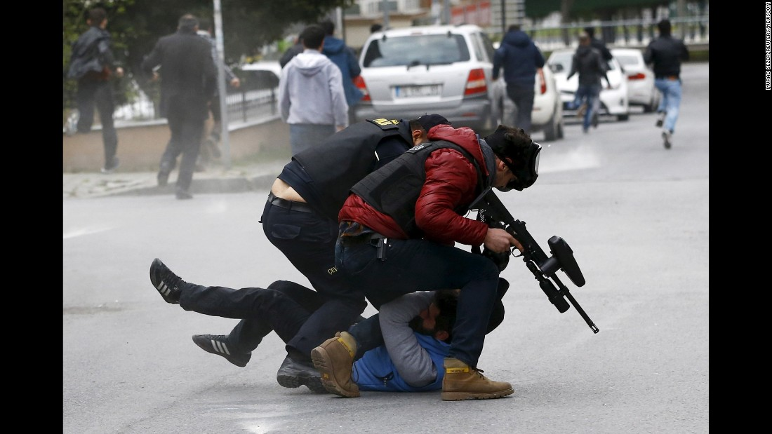 Riot police detain a pro-Kurdish demonstrator in Istanbul, where some people were celebrating the spring festival of Newroz despite a ban from the governorship on Sunday, March 20.