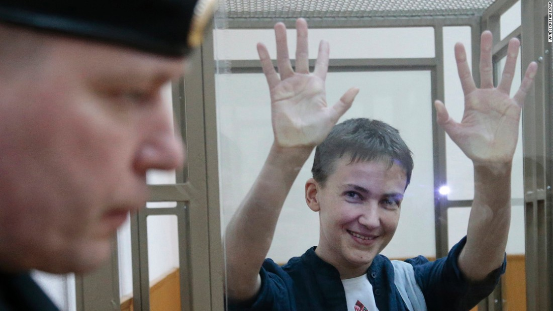 "Nadezhda Savchenko, a Ukrainian pilot charged in the deaths of two Russian journalists, waves to journalists from a glass cage in Donetsk, Russia, on Monday, March 21. The next day <a href=""http://www.independent.co.uk/news/world/europe/nadezhda-savchenko-found-guilty-over-journalists-murder-by-russian-court-a6946096.html"" target=""_blank"">she was found guilty </a>and sentenced to 22 years in prison. Savchenko has said she did not kill anyone, maintaining she was kidnapped in Ukraine and brought across the border into Russia before being charged. She says her detention is politically motivated."
