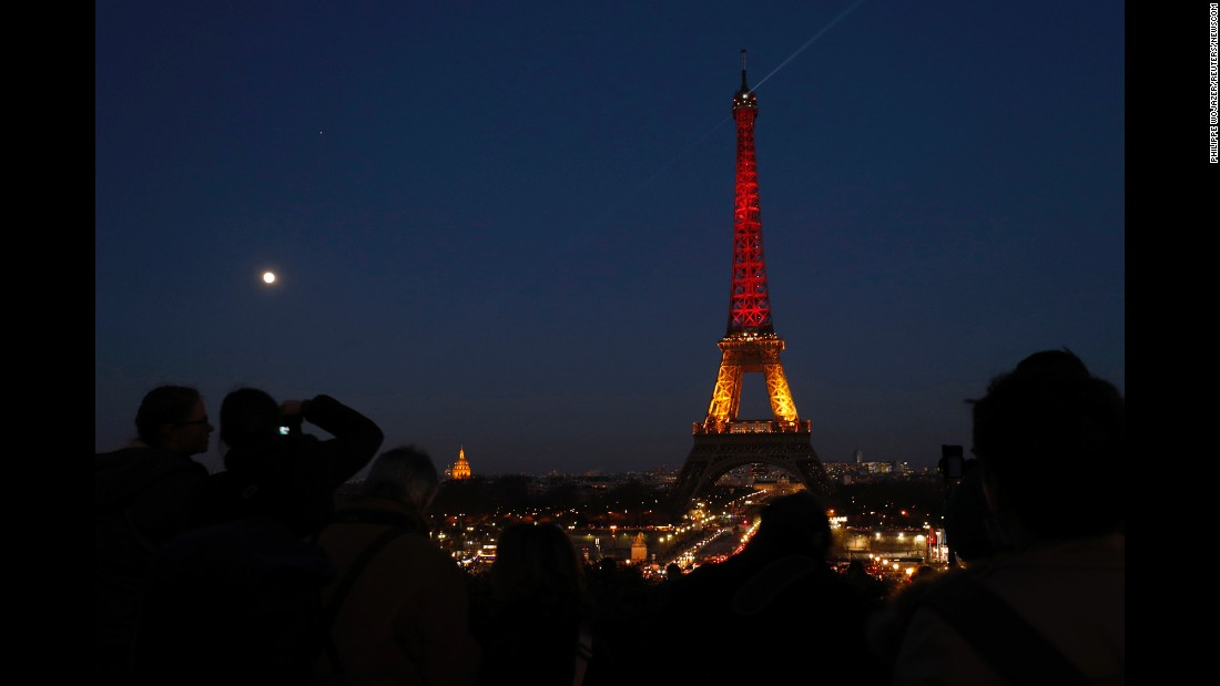 "The Eiffel Tower in Paris displays the colors of the Belgian flag after the terrorist attacks in Brussels on Tuesday, March 22. <a href=""http://www.cnn.com/2016/03/22/world/gallery/brussels-attack-reactions/index.html"" target=""_blank"">See more reaction from around the world </a>"
