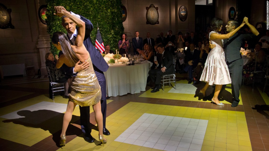 U.S. President Barack Obama, left, and first lady Michelle Obama, right, tango with dancers during a state dinner in Buenos Aires on Wednesday, March 23.