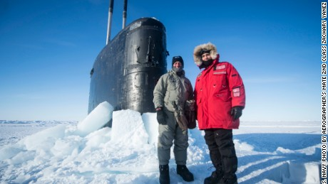 Navy sub emerges from under Arctic ice