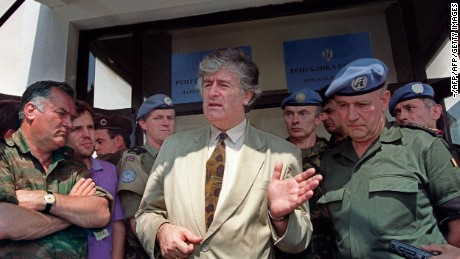 PALE, BOSNIA AND HERZEGOVINA:  Radovan Karadzic (C), Bosnian Serb warlord and leader of the Serb-run part of Bosnia during the 1992-1995 war, addresses media 05 August 1993 in his stronghold of Pale, while Ratko Mladic (L), his military commander, and UN High Commander for Bosnia, Belgian General Francis Briquemont (R) look on. Karadzic and Mladic, both at large, are indicted by the International Criminal Tribunal for the former Yugoslavia (ICTY) in The Hague for war crimes and genocide committed during Bosnia's war. AFP PHOTO (Photo credit should read Michael Evstafiev/AFP/Getty Images)