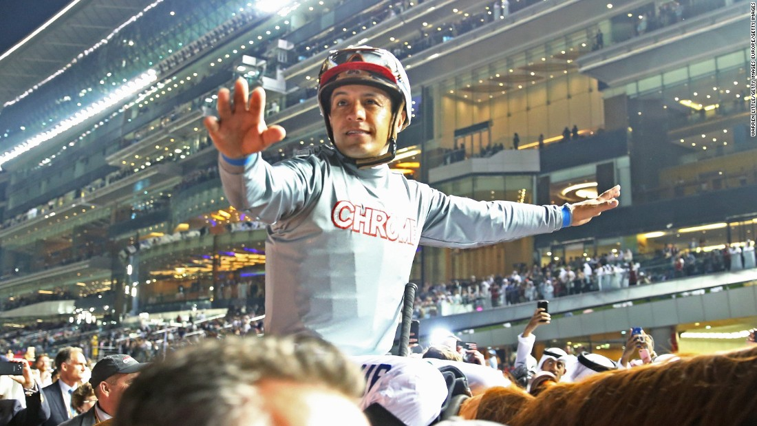 Victor Espinoza celebrates after riding California Chrome to victory in the Dubai World Cup to land the $6 million top prize.
