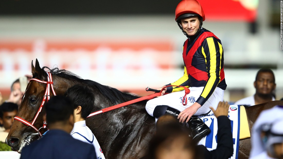 Jockey Ryan Moore celebrates after riding Real Steel to victory in the Dubai Turf at the $30 million World Cup meet.
